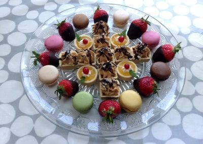 Sweet canapes with mixed Macarons from Foxes Catering